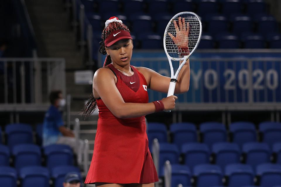 Seen here, Naomi Osaka prepares to leave court after exiting in the third round in Tokyo.