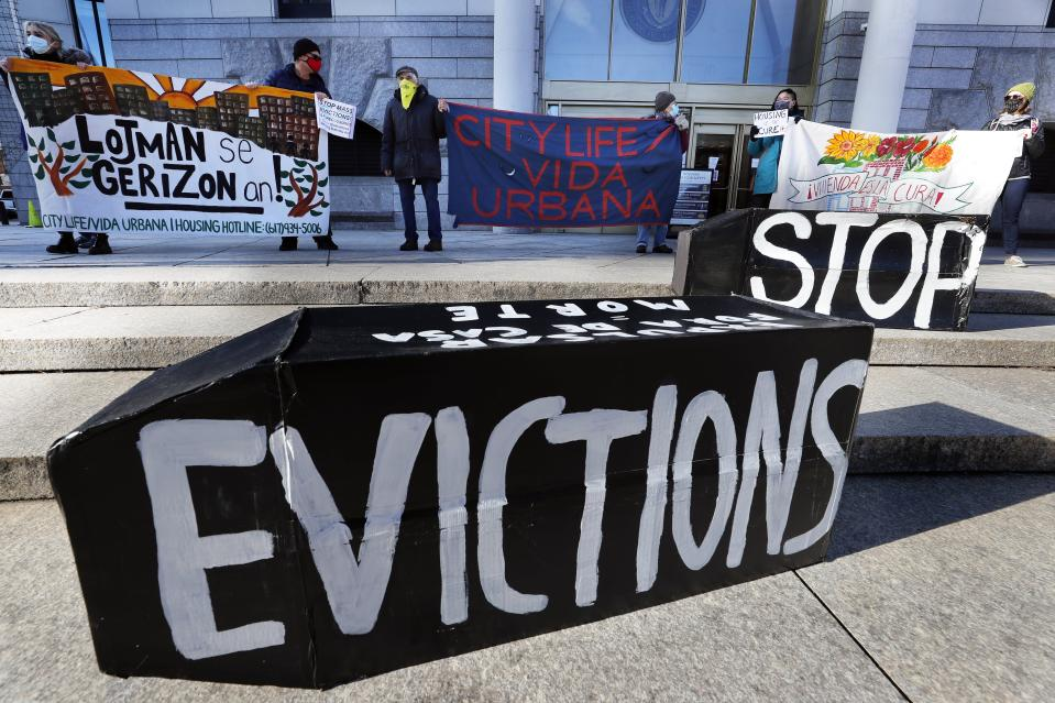 Tenants' rights advocates demonstrate in front of the Edward W. Brooke Courthouse, Wednesday, Jan. 13, 2021, in Boston. The protest was part of a national day of action calling on the incoming Biden administration to extend the eviction moratorium initiated in response to the Covid-19 pandemic. (AP Photo/Michael Dwyer)