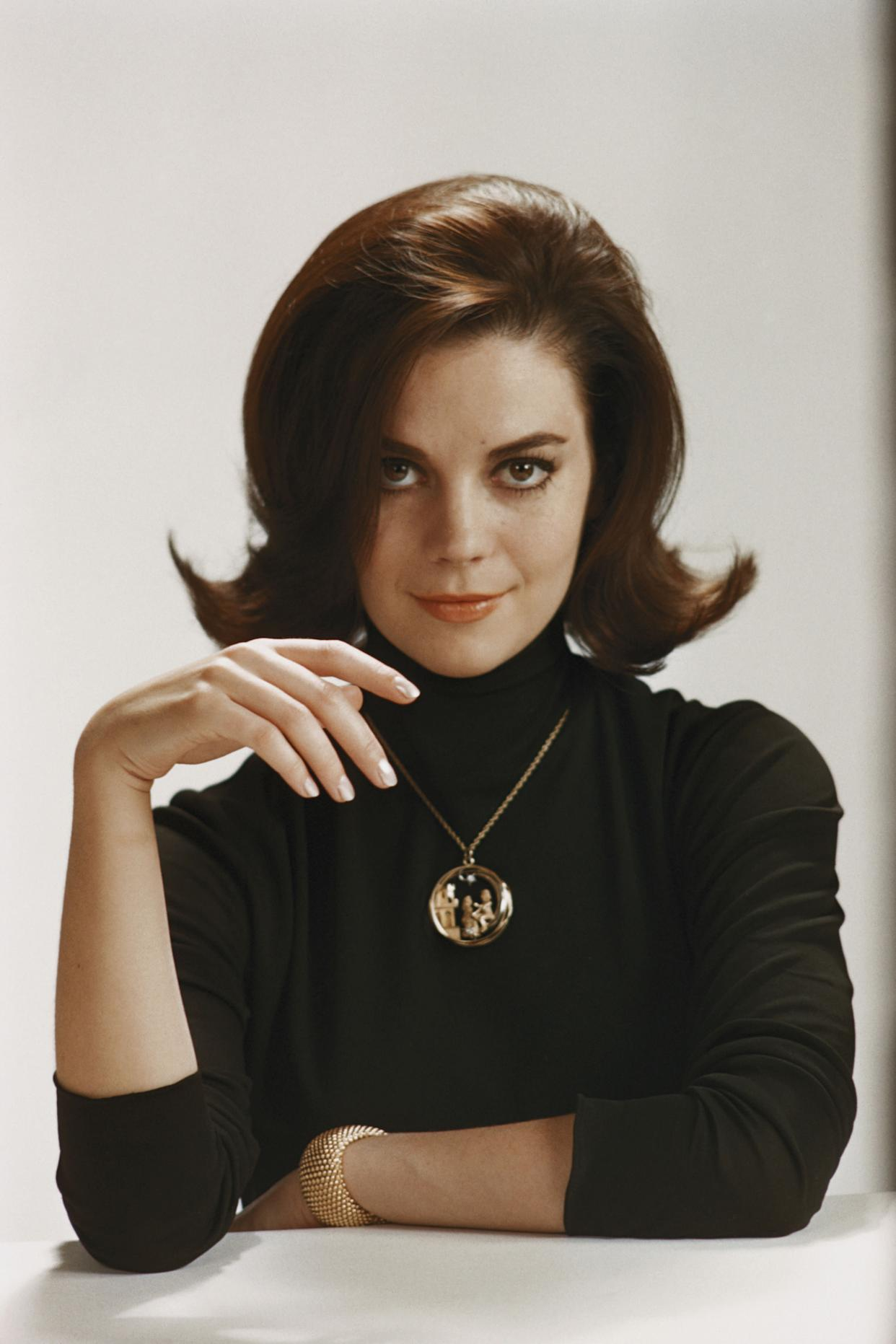 The actress wears a black turtleneck in this photo from the early '60s.