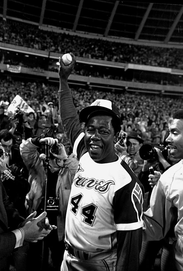 FILE - In this April 8, 1974 file photo, Atlanta Braves baseball player Hank Aaron holds the ball he hit for his 715th home run during a game against the Los Angeles Dodgers, in Atlanta. The 40th anniversary of Aaron's 715th home run finds the Hall of Famer, now 80, coping with his recovery from hip surgery. The anniversary of his famous homer on April 8, 1974 will be celebrated before the Braves' home opener against the Mets on Tuesday night. (AP Photo/Bob Daugherty, File)