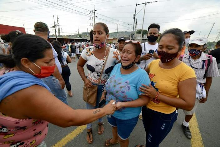 Relatives of prisoners caught up in Tuesday's violence gathered for news on the fate of their loved ones