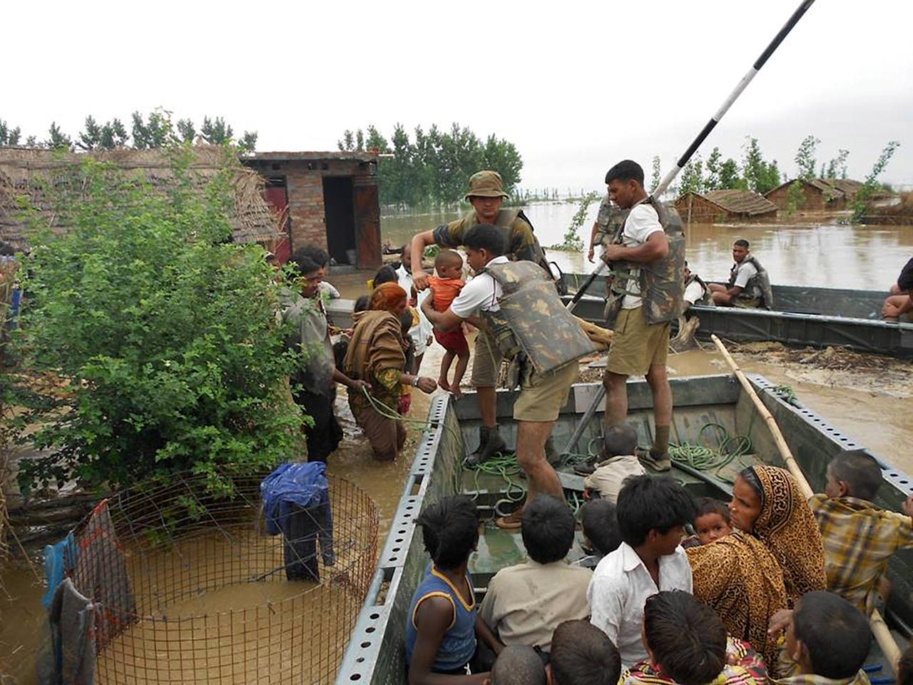"""In this photograph received from the Defence Ministry on June 19, 2013 members of the Indian Defence Forces rescue stranded villagers in the northern Uttarakhand state.   Military helicopters dropped emergency supplies June 19 to thousands of people stranded by flash floods that tore through towns and temples in northern India and neighbouring Nepal, killing more than 160, officials said.  AFP PHOTO/DEFENCE MINISTRY     ----EDITORS NOTE---- RESTRICTED TO EDITORIAL USE - MANDATORY CREDIT -  """"AFP PHOTO / DEFENCE MINISTRY"""" - NO MARKETING NO ADVERTISING CAMPAIGNS - DISTRIBUTED AS A SERVICE TO CLIENTS -----"""
