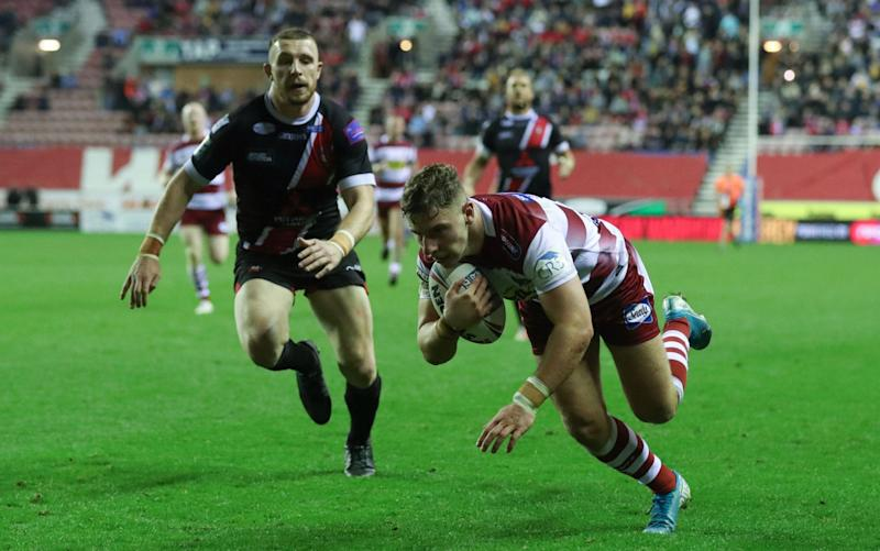 George Williams goes over to score Wigan's third try - REX
