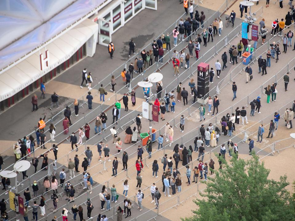 Long queues formed outside an NHS vaccination clinic at West Ham's London Stadium in Stratford, east London (PA)