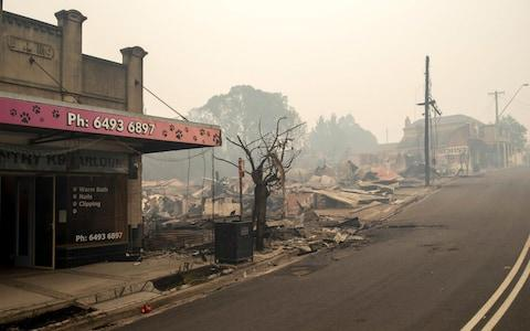 The rubble of buildings sits on the ground after they were destroyed by fire in Cobargo, New South Wales - Credit: Rex