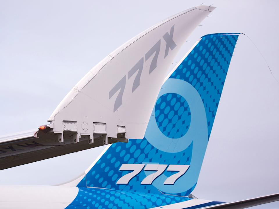 A Boeing 777X aircraft preparing for takeoff.