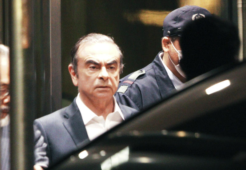 Former Nissan Chairman Carlos Ghosn leaves the Tokyo Detention Center, in Tokyo Thursday, April 25, 2019. Ghosn walked out of detention Thursday evening, his head held high, after a Japanese court rejected an appeal from prosecutors and his 500 million yen ($4.5 million) in bail was paid earlier in the day. (AP Photo/Eugene Hoshiko)