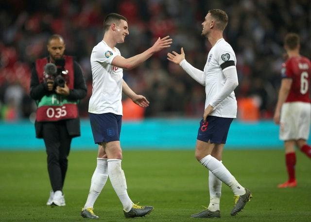 Rice has also revealed what he is learning by playing alongside Jordan Henderson (right).