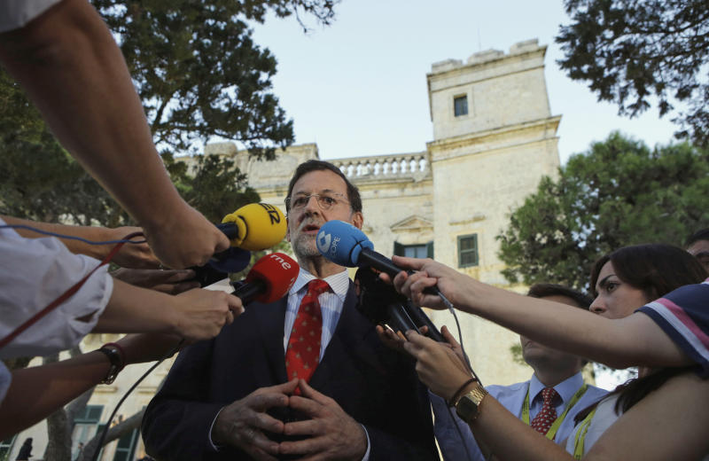 Spain's Prime Minister Mariano Rajoy addresses the press as he attends a Mediterranean summit of southern European and North African countries, in Valletta, Malta, Friday, Oct. 5, 2012.The Malta summit of five European and five African nations is expected to focus on fighting terrorism and lawlessness in North African as well as France's push for a military intervention in Mali, where Islamist rebels have taken control in the north. (AP Photo/Andrew Medichini)
