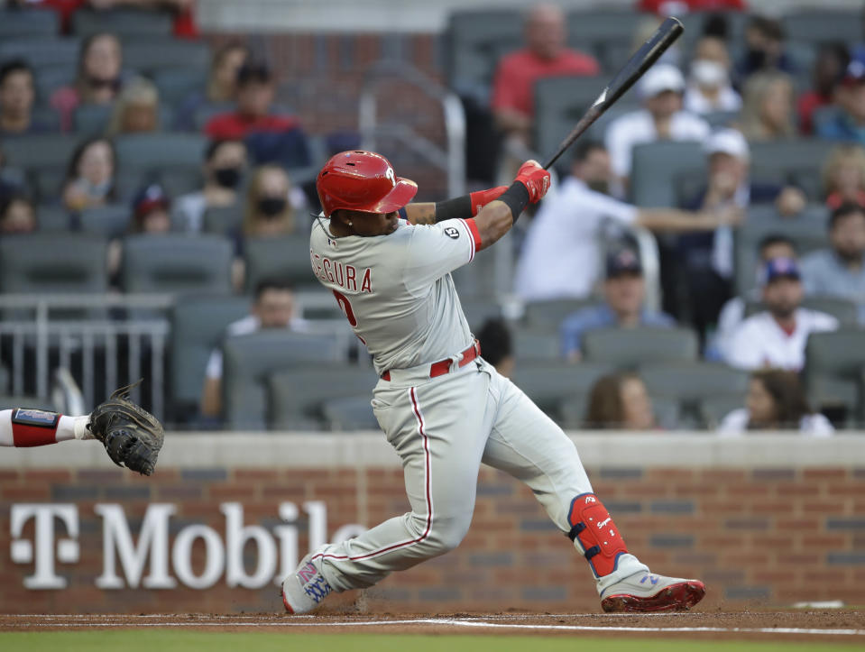 Philadelphia Phillies' Jean Segura swings for a home run off Atlanta Braves pitcher Ian Anderson in the first inning of a baseball game Saturday, May 8, 2021, in Atlanta. (AP Photo/Ben Margot)