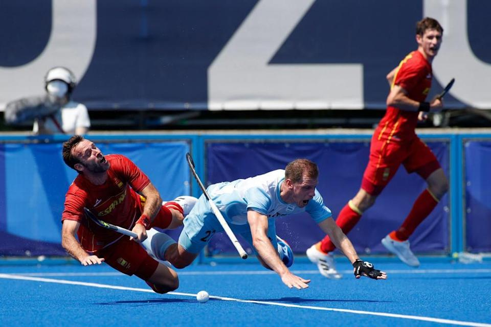 Lucas Rossi of Argentina and David Alegre of Spain tangle during a combustible game between the two nation.