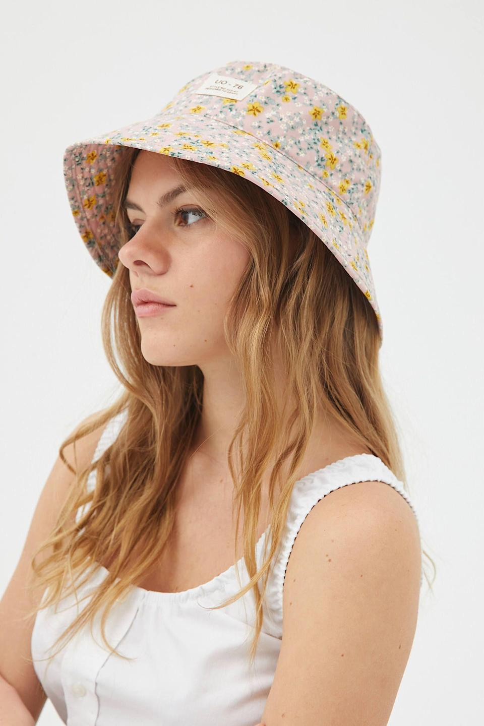 """<p><strong>Urban Outfitters</strong></p><p>urbanoutfitters.com</p><p><strong>$24.00</strong></p><p><a href=""""https://go.redirectingat.com?id=74968X1596630&url=https%3A%2F%2Fwww.urbanoutfitters.com%2Fshop%2Fuo-pixie-printed-bucket-hat&sref=https%3A%2F%2Fwww.womenshealthmag.com%2Flife%2Fg33503014%2Fsecret-santa-gifts%2F"""" rel=""""nofollow noopener"""" target=""""_blank"""" data-ylk=""""slk:Shop Now"""" class=""""link rapid-noclick-resp"""">Shop Now</a></p><p>A cute floral bucket hat is a stylish gift any friend will love. This one comes in a pretty pink or a bold navy, so you can grab the one that will match the rest of her closet!</p>"""