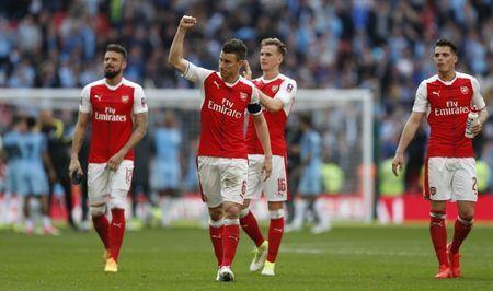 Britain Football Soccer - Arsenal v Manchester City - FA Cup Semi Final - Wembley Stadium - 23/4/17 Arsenal's Laurent Koscielny, Olivier Giroud, Rob Holding and Granit Xhaka celebrate after the match Action Images via Reuters / John Sibley Livepic