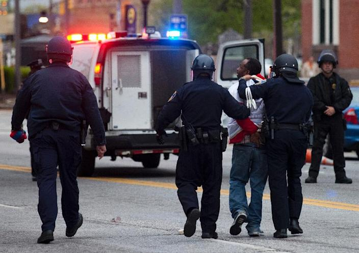 Police arrest a protester during a demonstration in Baltimore, Maryland, on April 25, 2015 (AFP Photo/Andrew Caballero-Reynolds)