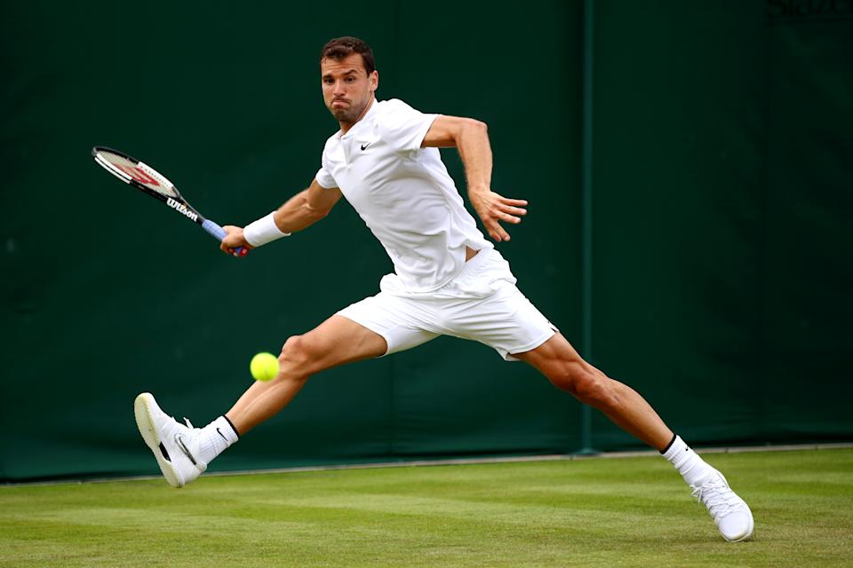 Grigor Dimitrov of Bulgaria stretches to play a forehand in his Men's Singles first round match against Corentin Moutet of France during Day one of The Championships - Wimbledon 2019 at All England Lawn Tennis and Croquet Club on July 01, 2019 in London, England. (Photo by Clive Brunskill/Getty Images)