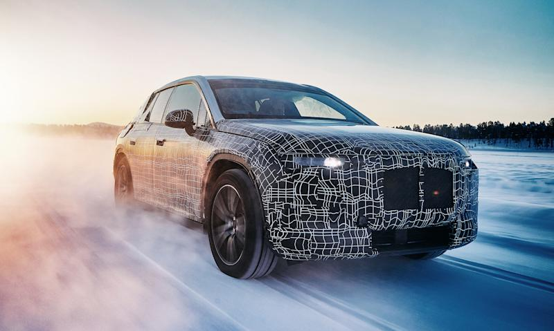 A prototype BMW iNEXT, a big electric luxury SUV, shown undergoing winter testing.