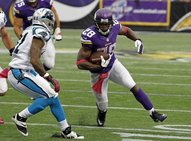 Carolina Panthers cornerback Captain Munnerlyn, left, chases down Minnesota Vikings running back Adrian Peterson during the first half of an NFL football game in Minneapolis, Sunday, Oct. 13, 2013. (AP Photo/Ann Heisenfelt)