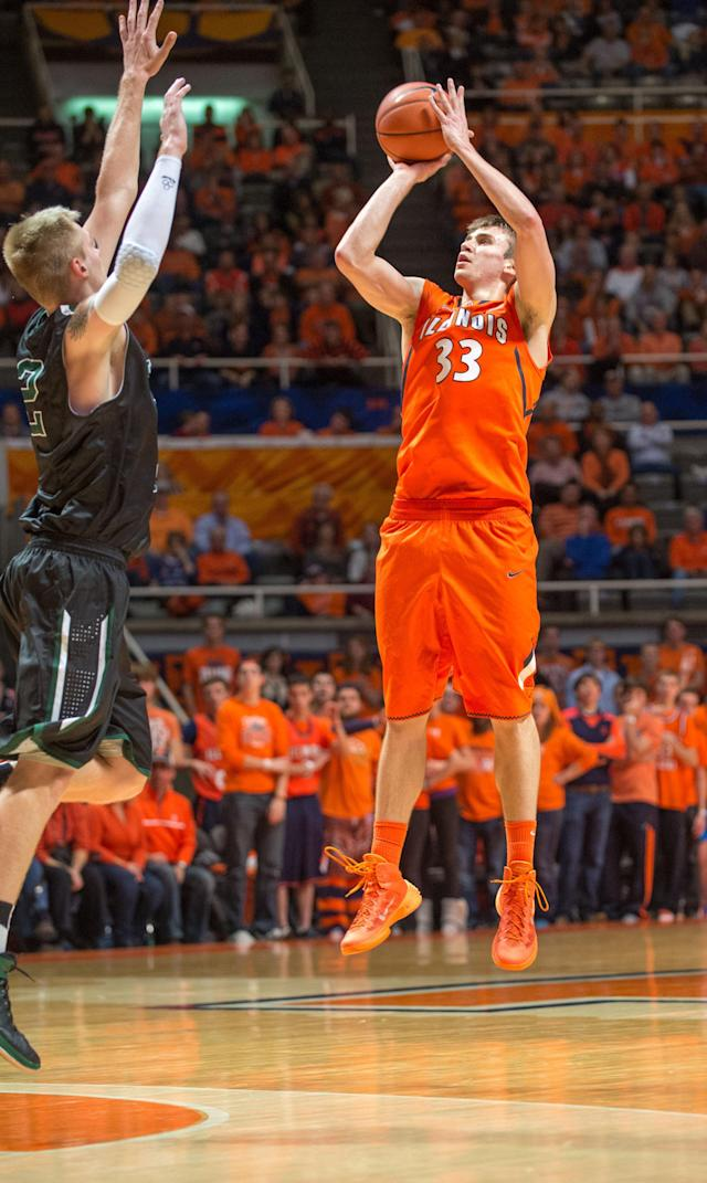 Illinois' Jon Ekey (33) puts up a three-point basket past Chicago State's Matt Ross (42) during the second half of an NCAA college basketball game on Friday, Nov. 22, 2013, in Champaign, Ill. Illinois defeated Chicago State 77-53. (AP Photo/Darrell Hoemann)