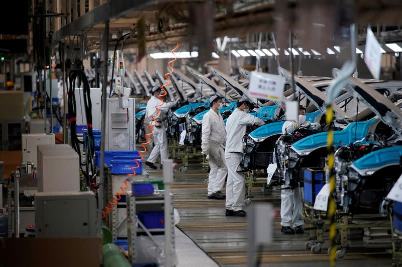 FILE PHOTO: Employees work on a production line inside a Dongfeng Honda factory in Wuhan