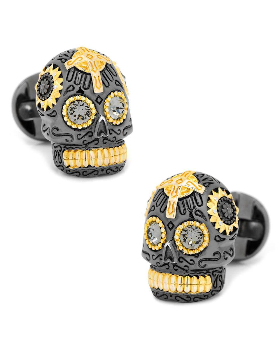 "<p><strong>Cufflinks Inc.</strong></p><p>neimanmarcus.com</p><p><strong>$220.00</strong></p><p><a href=""https://www.neimanmarcus.com/p/cufflinks-inc-3d-day-of-the-dead-sugar-skull-cuff-links-black-gold-prod197910372"" rel=""nofollow noopener"" target=""_blank"" data-ylk=""slk:Shop Now"" class=""link rapid-noclick-resp"">Shop Now</a></p><p>We feel the exuberance of these Día de los Muertos–inspired cuff links in our bones. </p>"