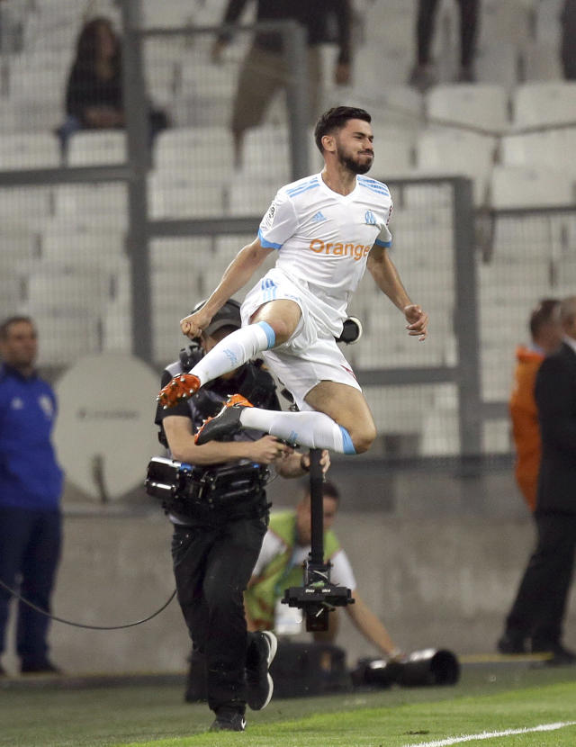 Marseille's midfielder Morgan Sanson, celebrates after scoring during the League One soccer match between Marseille and Amiens at the Velodrome stadium, in Marseille, southern France, Saturday, May 19, 2018. (AP Photo/Claude Paris)
