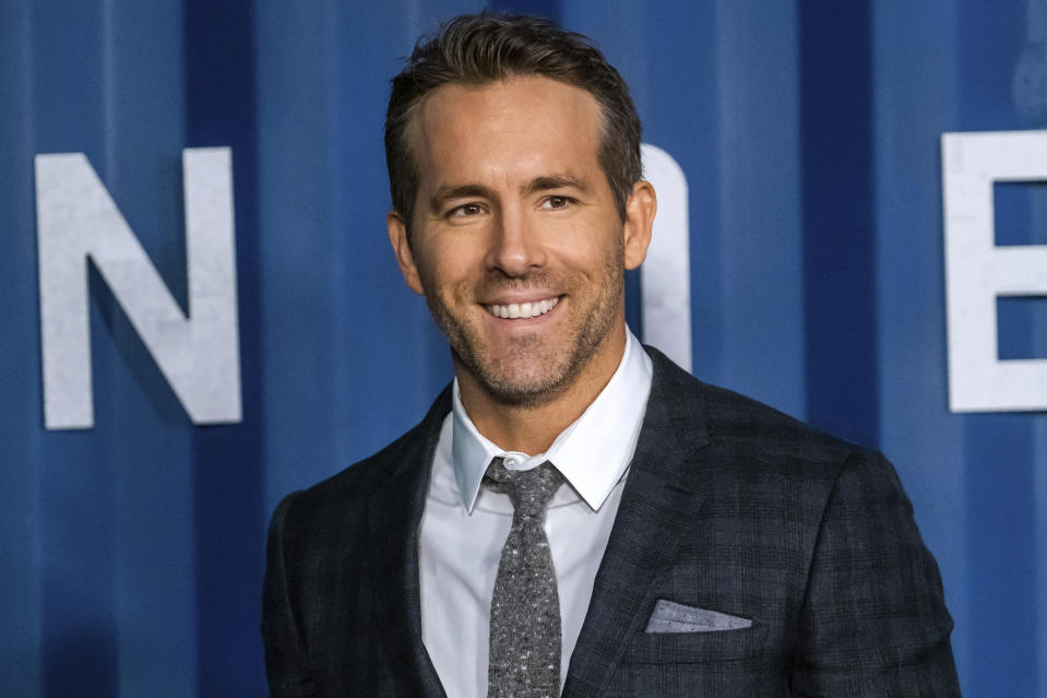 "FILE - In this Tuesday, Dec. 10, 2019 file photo, Ryan Reynolds attends the premiere of Netflix's ""6 Underground"" at The Shed at Hudson Yards on in New York. Hollywood stars Ryan Reynolds and Rob McElhenney could be getting into the soccer business. Wrexham is a Welsh team which plays in the fifth tier of English soccer. It has revealed on Wednesday, Sept. 23, 2020 that Reynolds and McElhenney are the ""two extremely well-known individuals"" the club has previously said are interested in investing 2 million pounds ($2.5 million). (Photo by Charles Sykes/Invision/AP, file)"