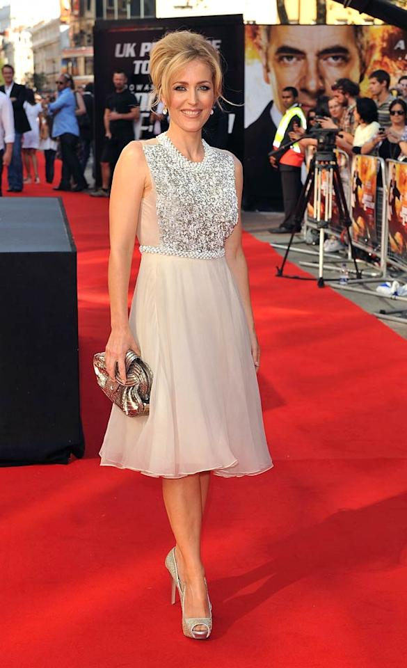 "We haven't seen Gillian Anderson on the red carpet in quite some time, but the former ""X-Files"" star made a triumphant return upon arriving at the U.K. premiere of ""Johnny English Reborn."" The 43-year-old mom-of-three looked more glamorous than ever thanks to her flawlessly embellished frock, champagne-colored peep-toes, and a chic updo.  Ferdaus Shamim/WireImage.com - October 2, 2011"