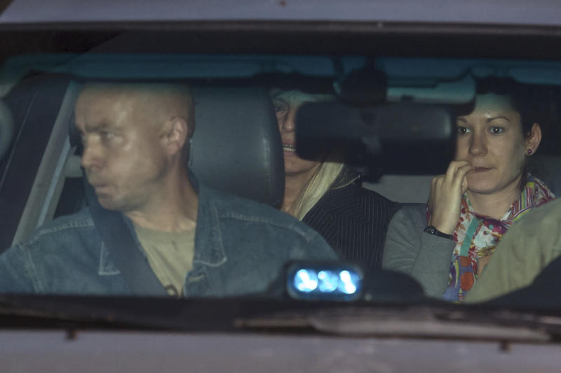 Michelle Martin, partially obscured at center, ex-wife of Belgium's child killer Marc Dutroux leaves prison in Brussels, Tuesday Aug. 28, 2012.  Belgium's highest court granted conditional early release Tuesday to one of the nation's most despised criminals, the accomplice and former wife of a pedophile and child killer, even though she let two of his victims starve to death.  The Belgium court is allowing Michelle Martin to live in a convent after serving barely half her 30-year sentence for her part in the mid-1990s kidnappings, rapes and killings by her then-husband, Marc Dutroux. (AP Photo/Geert Vanden Wijngaert)