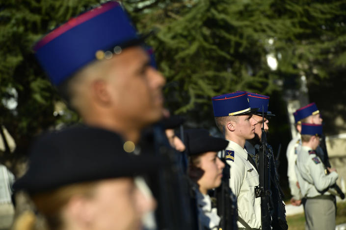 French soldiers attends a ceremony in tribute to French soldiers who died in Mali helicopter crash, Monday Jan.13, 2020 in Pau, southwestern France. France is preparing its military to better target Islamic extremists in a West African region that has seen a surge of deadly violence. (AP Photo/Alvaro Barrientos, Pool)
