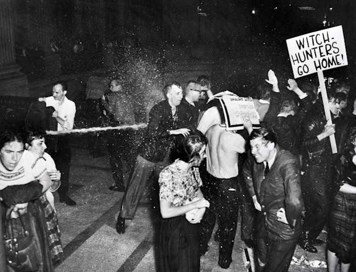 Police hose demonstrators in San Francisco City Hall who are protesting against the House Un-American Activities Committee in 1960. (Bettmann Archive/Getty Images)