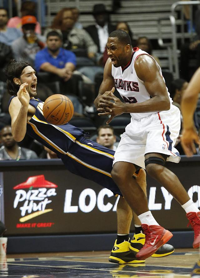 Atlanta Hawks power forward Elton Brand (42) collides with Indiana Pacers power forward Luis Scola (4) in the first half of an NBA basketball game, Tuesday, Feb. 4, 2014, in Atlanta. Brand was called for an offensive foul. (AP Photo/John Bazemore)