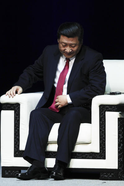 In this Aug. 21, 2012 photo, Chinese Vice President Xi Jinping takes his seat during an opening ceremony for the 28th General Assembly of International Astronomical Union (IAU) in Beijing, China. Xi has not been seen in public since Sept. 1, fueling speculation that he suffered a health crisis that forced him to cancel meetings with Hillary Clinton and others. (AP Photo/Alexander F. Yuan)