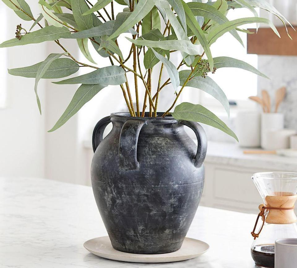 """<p><strong>Pottery Barn</strong></p><p>potterybarn.com</p><p><strong>$39.50</strong></p><p><a href=""""https://go.redirectingat.com?id=74968X1596630&url=https%3A%2F%2Fwww.potterybarn.com%2Fproducts%2Fdreamy-eucalyptus-gtl-sp21%2F%3Fpkey%3Dcvase&sref=https%3A%2F%2Fwww.harpersbazaar.com%2Ffashion%2Ftrends%2Fg36889474%2Finterior-design-mistakes-to-avoid%2F"""" rel=""""nofollow noopener"""" target=""""_blank"""" data-ylk=""""slk:Shop Now"""" class=""""link rapid-noclick-resp"""">Shop Now</a></p><p>It's all in the good, proportionally sized accessories.</p>"""