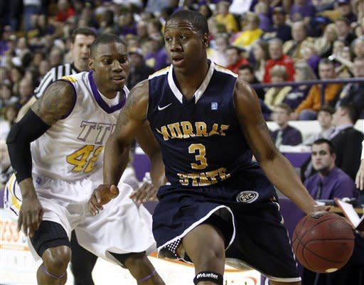 Murray State's Isaiah Canaan (3) drives past Tennessee Tech's Zach Bailey (42) in the first half of an NCAA college basketball game on Saturday, Feb. 25, 2012, in Cookeville, Tenn. (AP Photo/Wade Payne)