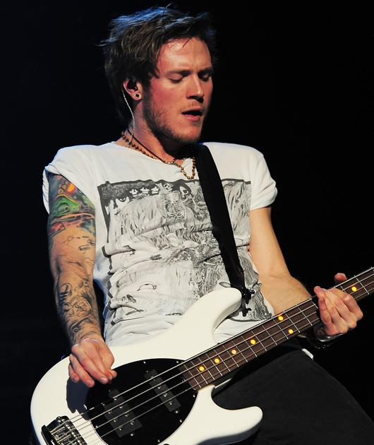 Dougie Poynter photos: In action and oh so adorable.