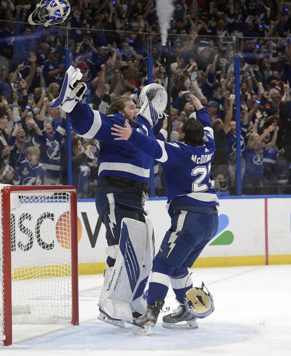 FILE - In this July 7, 2021, file photo, Tampa Bay Lightning defenseman Ryan McDonagh (27) and goaltender Andrei Vasilevskiy (88) celebrate the team's Stanley Cup series win in Game 5 of the NHL hockey finals in Tampa, Fla. (AP Photo/Phelan Ebenhack, File)