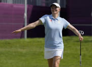 Madelene Sagstrom, of Sweden, celebrates after a birdie putt on the 15th hole during the first round of the women's golf event at the 2020 Summer Olympics, Wednesday, Aug. 4, 2021, at the Kasumigaseki Country Club in Kawagoe, Japan. (AP Photo/Andy Wong)