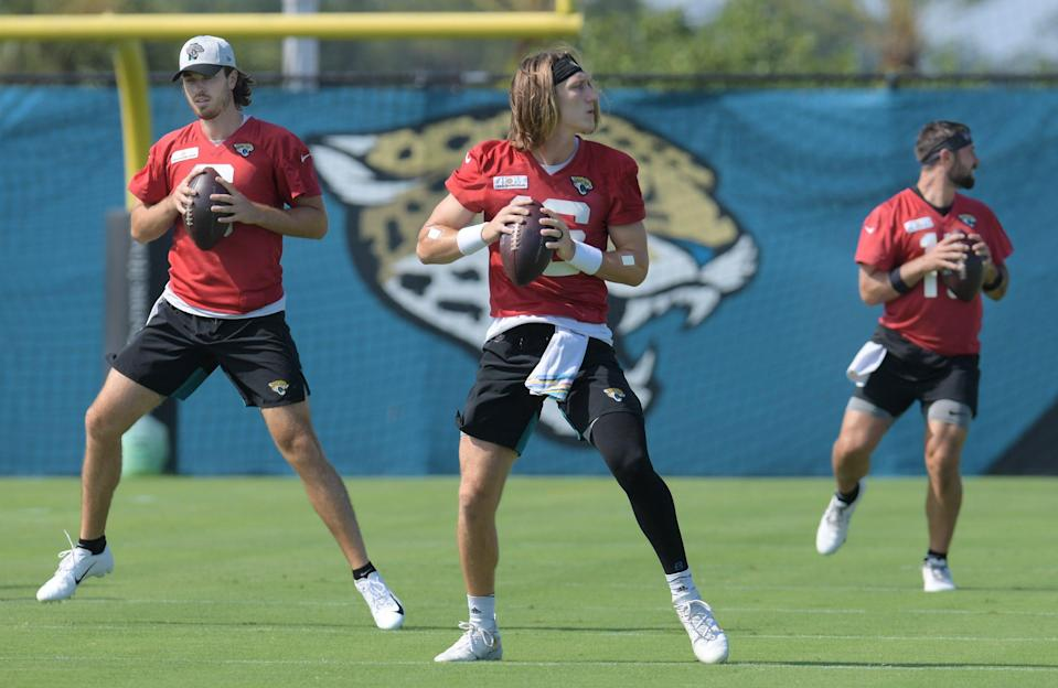 Jaguars quarterbacks (3) C.J. Beathard, (16) Trevor Lawrence and (15) Gardner Minshew II during drills at Tuesday's minicamp session. The Jacksonville Jaguars held their Tuesday morning session of the team's mandatory minicamp at the practice fields outside TIAA Bank Field, June 15, 2021. [Bob Self/Florida Times-Union]