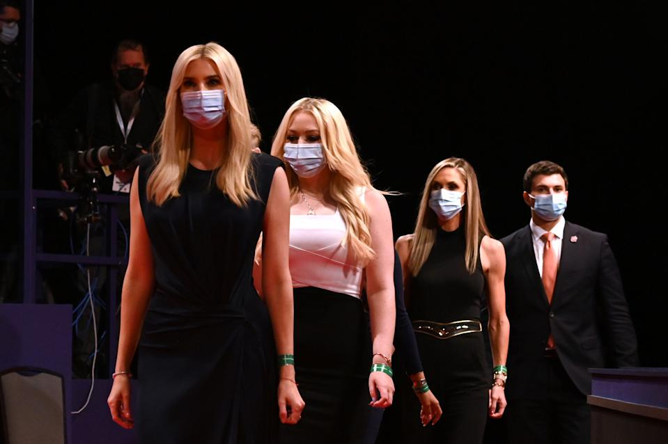 (From L) Daughter and Senior Advisor to the US President Ivanka Trump, daughter of the US President Tiffany Trump, campaign adviser to the US President and Eric Trump's wife Lara Trump wear facemasks as they arrive to attend the final presidential debate at Belmont University in Nashville, Tennessee, on October 22, 2020.
