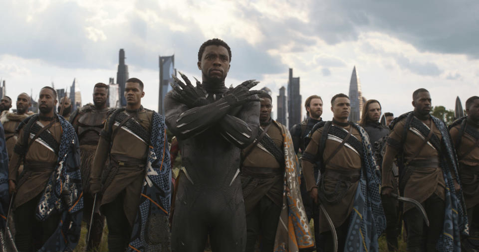 "This image released by Disney shows Chadwick Boseman, center, in a scene from Marvel Studios' ""Avengers: Infinity War."" (Marvel Studios via AP)"