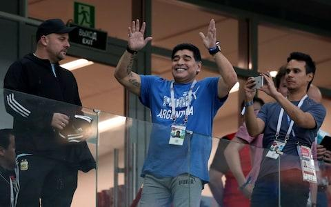 Diego Maradona salutes crowd - Credit: REUTERS