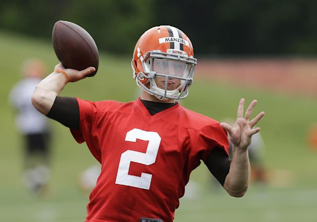 FILE - In this June 10, 2014, file photo, Cleveland Browns quarterback Johnny Manziel passes during a mandatory minicamp practice at the NFL football team's facility in Berea, Ohio. After months of having his off-field behavior analyzed, scrutinized and criticized, Manziel will again be the center of attention. (AP Photo/Mark Duncan, File)
