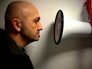 Man facing a loudspeaker