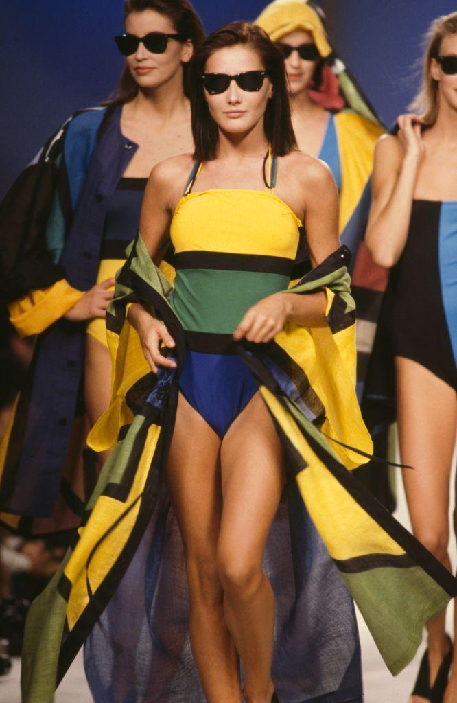 <p>Carla Bruni and other models wear color-blocked maillots at Jean-Charles de Castelbajac's spring 1987 fashion show. </p>