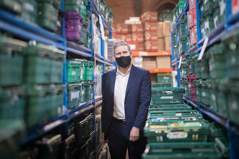 <p>Labour leader Keir Starmer visits a food bank distribution centre in St Margaret The Queen church in Streatham, ahead of the Commons vote on the Government's plan to cut the £20-a-week uplift to Universal Credit</p> (PA)
