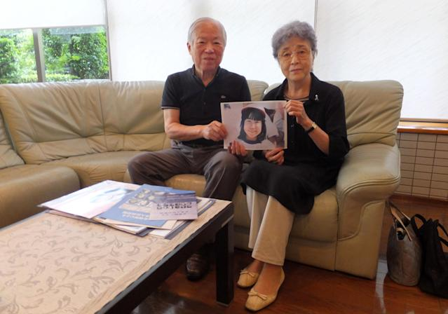 Shigeru Yokota, left, and his wife, Sakie, hold a portrait of their daughter Megumi. (Photo: Maiko Takahashi/Bloomberg via Getty Images)