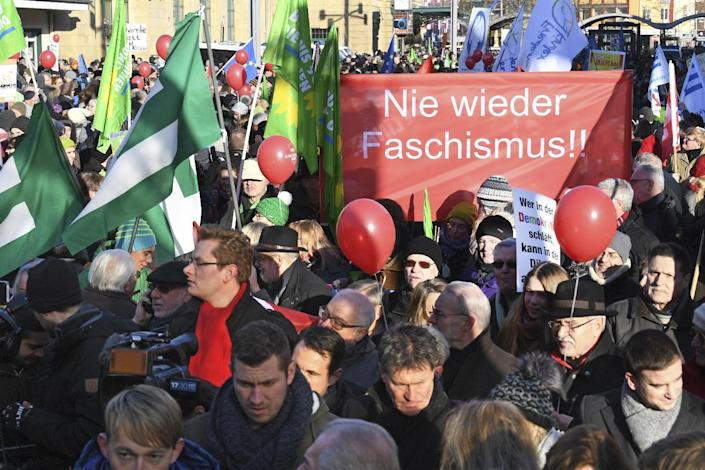 """People demonstrate against a meeting of European nationalists in Koblenz, Germany, Saturday, Jan. 21, 2017. Dutch populist anti-Islam lawmaker Geert Wilders, AfD (Alternative for Germany) chairwoman Frauke Petry, far-right leader and candidate for next spring presidential elections Marine le Pen from France and Italian Lega Nord chief Matteo Salvini will attend the meeting. Banner reads """"Never again Fascism"""". (Boris Roessler/dpa via AP)"""