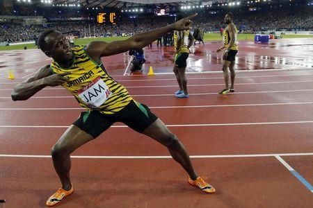 Jamaica's Bolt poses after Jamaica won the men's 4x100m relay final at the 2014 Commonwealth Games in Glasgow
