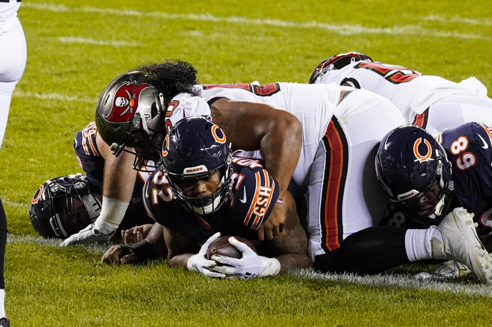 Chicago Bears running back David Montgomery (32) is tackled in the end zone by Tampa Bay Buccaneers nose tackle Vita Vea (50) after a touchdown. (AP Photo/Nam Y. Huh)