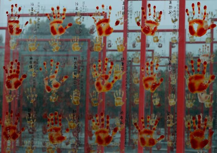 An artwork depicting the violence of the Cultural Revolution on display at Fan Jianchuan's museum near Chengdu, in Sichuan province (AFP Photo/Mark Ralston)